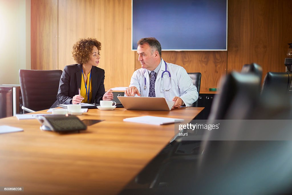 senior doctor with administrator : Stock Photo