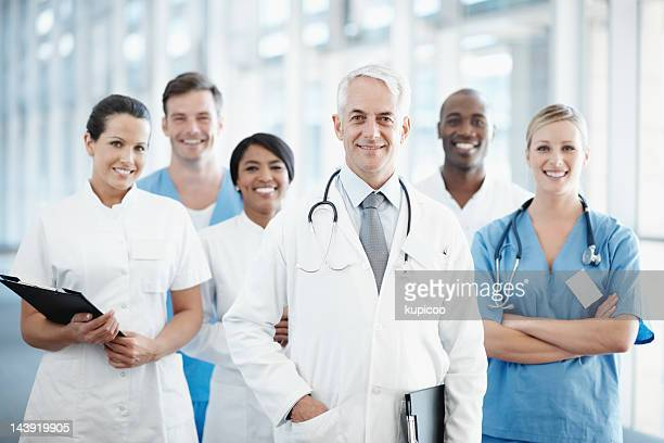 Senior doctor with successful medical team