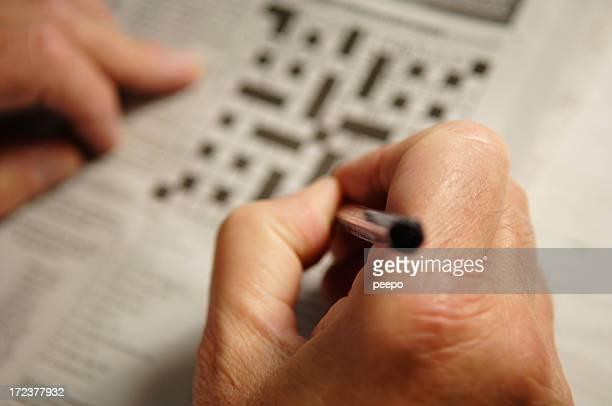 senior doing crossword puzzle