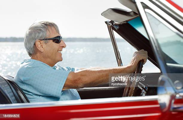 Senior driving convertible car