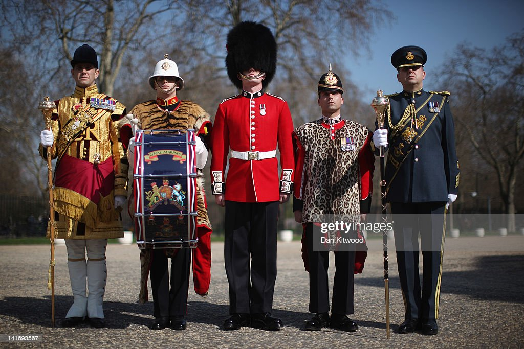 Senior Drum Major Betts of the Scotts Guard, Bugler Lee Kidd, Guardsman Adam Deer of the Coldstream Guards and Lance corporal Michael Strong of the Princess of Wales's Royal Regiment pose in their full ceremonial attire at Wellington Barracks on March 21, 2012 in London, England. The group make up part of the ceremonial military personnel who will play a key role during Her Majesty the Queens Diamond Jubilee celebrations between June 2 - 5.