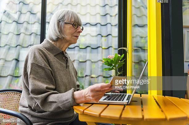 Senior Dutch woman using financital technology