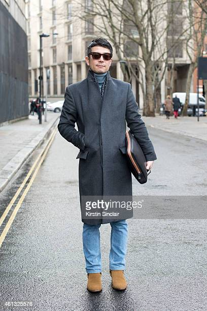 Senior editor for Leon magazine Hiroyuki Horikawa wearing Martin Margiela boots coat and scarf Todds bag and Tom Ford sunglasses on day 2 of London...