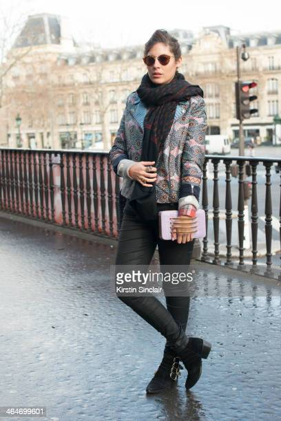 Senior editor for Stylecom Arabia Sofia Guellaty wears Toga Pulla boots BLK DNM jeans Suno jacket Ralph Lauren sunglasses Chinti and Parker sweater...