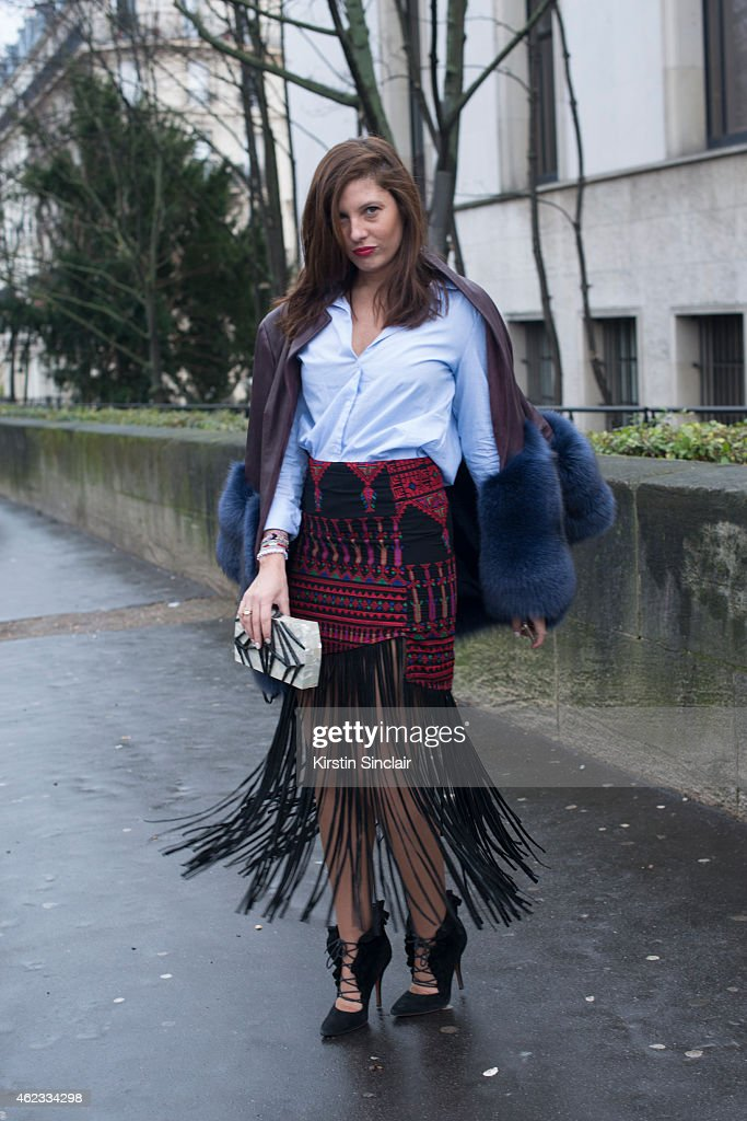 Senior Editor of Stylecom Arabia Sophia Guellaty wears a coat by Madiyah Al Sharqi Mochi skirt Zara shirt Alia shoes and Nathalie Trad clutch on day...