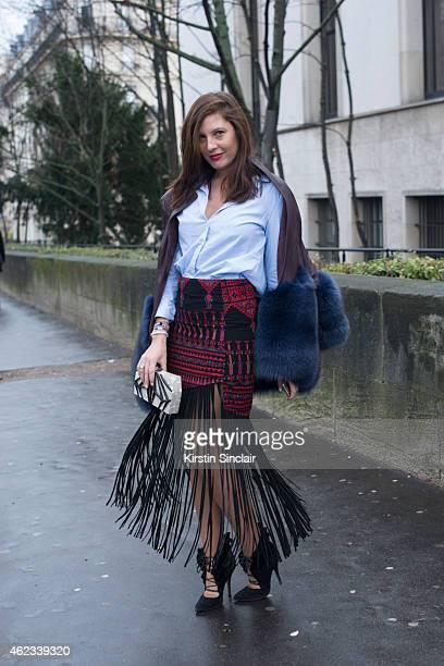 Senior Editor of Stylecom Arabia Sophia Guellaty wears a coat by Madiyah Al Sharqi Mochi skirt Zara shirt Alia shoes and Nathalie Trad clutch on day...