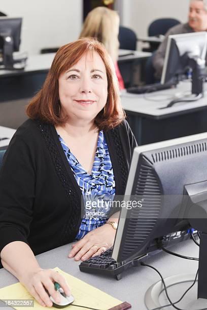 A senior enjoying her computer class
