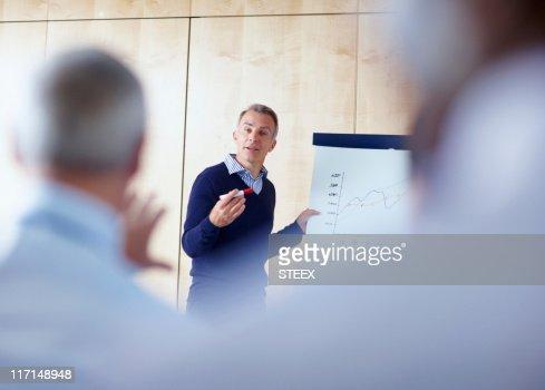 Senior executive giving presentation