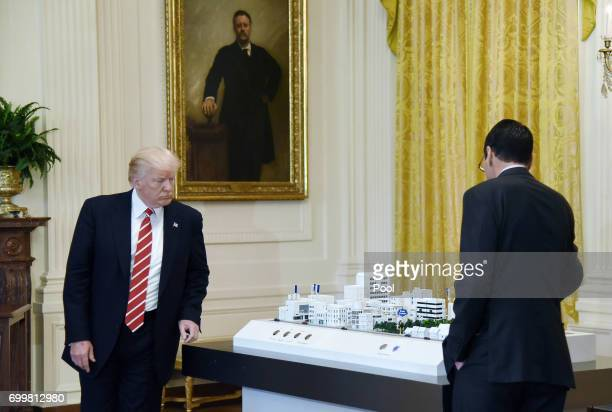 ATT Senior Executive Randall Stephenson explains to President Donald Trump how the 5G will be deployed in cities during the American Leadership in...