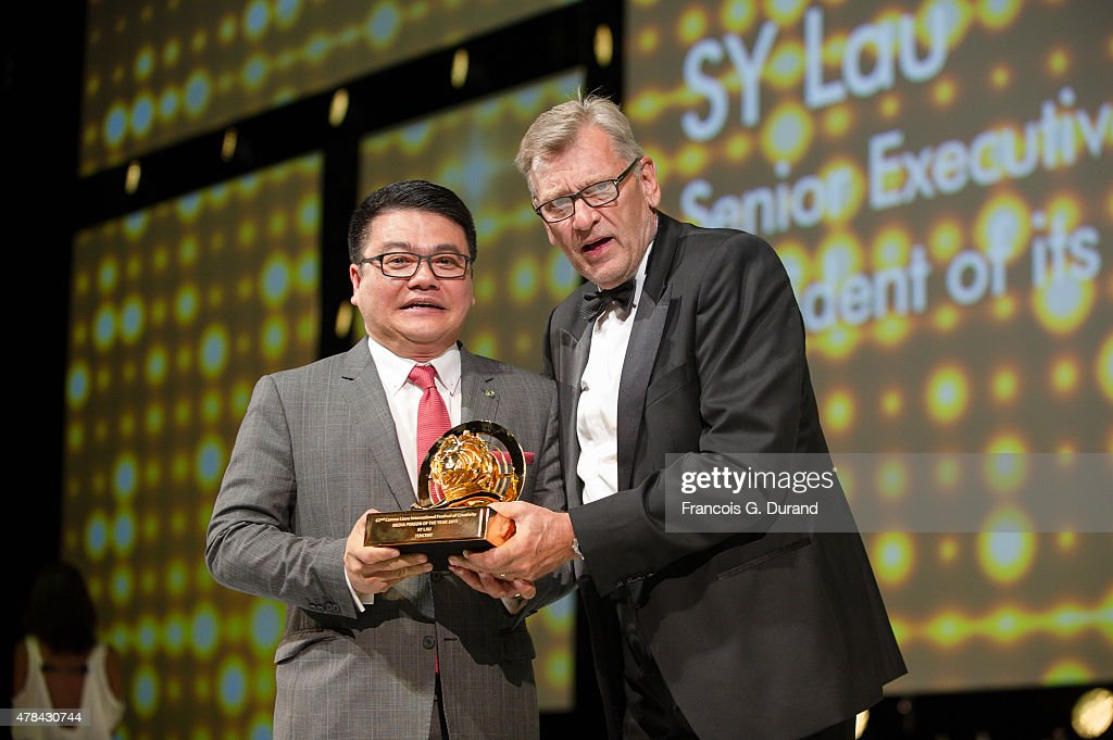 Senior Executive Vice President of Tencent and President of its Online Media Group, Sy Lau receives the Media person of the year award from Chairman of Lions Festivals Terry Savage during the Cannes Lions International Festival of Creativity on June 24, 2015 in Cannes, France.