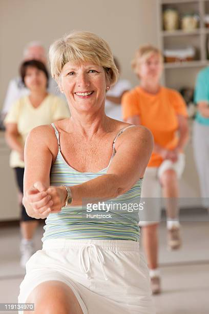 Senior exercise class doing stretches and cardio