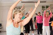 Senior exercise class doing stretching exercise