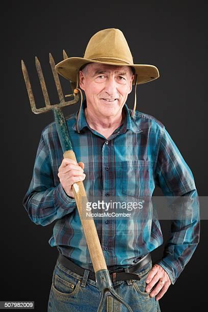 Senior farmer with pitch fork