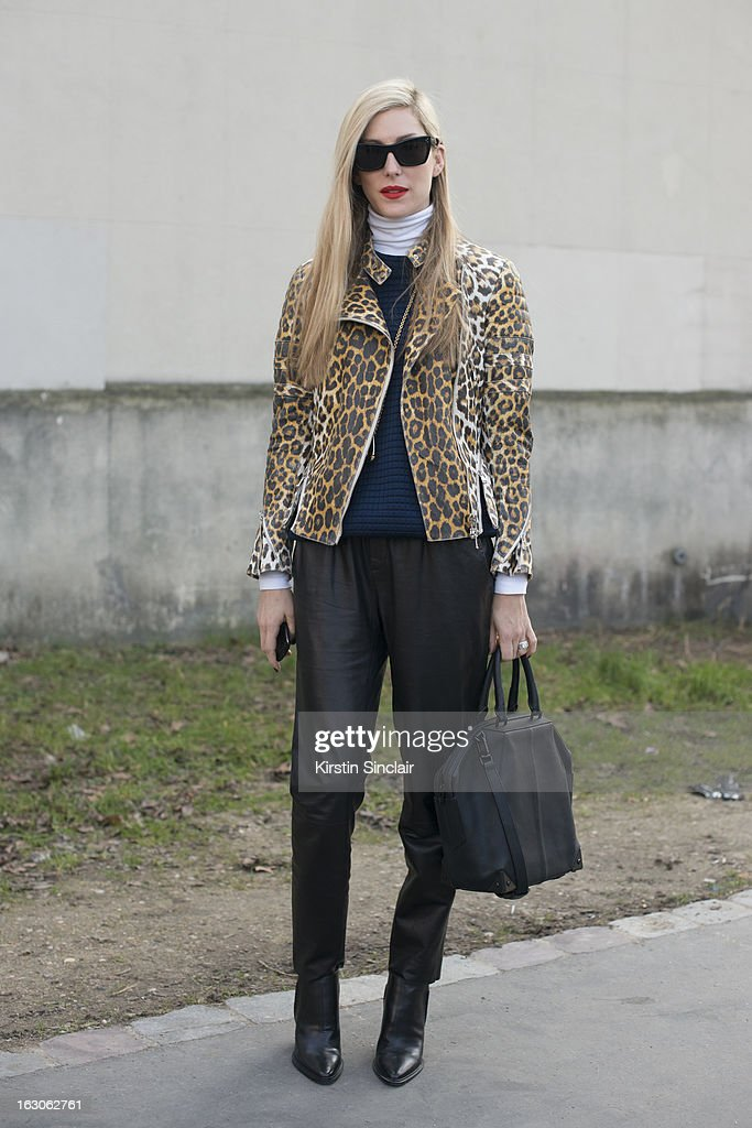 Senior fashion market editor for Harpers Bazaar U.S Joanna Hillman wears Alexander Wang shoes and bag, Celine glasses, Vince pants, Phillip Lim jacket and a Derek Lam sweater on day 4 of Paris Womens Fashion Week Autumn/Winter 2013 on March 03, 2013 in Paris, France.