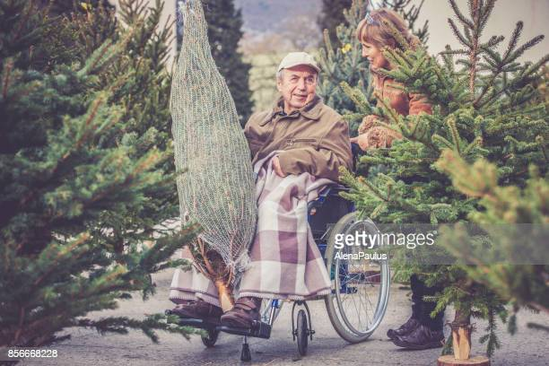 Senior Father and Daughter Shopping Christmas Tree