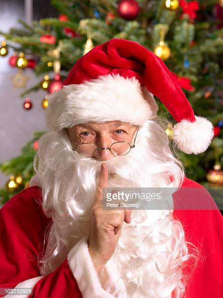 Senior father christmas asking for silence