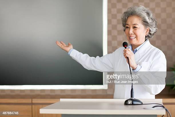 Senior female doctor giving a speech