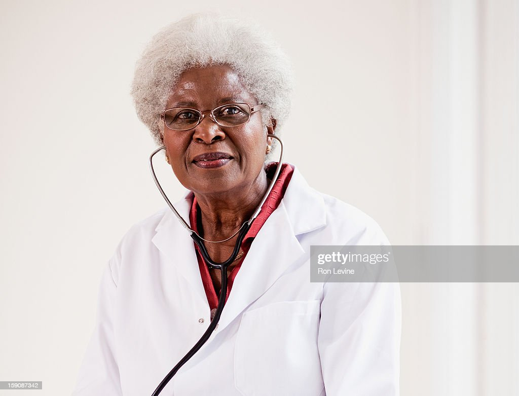 Senior female doctor with a stethoscope : Stock Photo