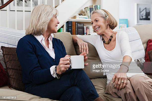 Senior female friends having coffee and a chat