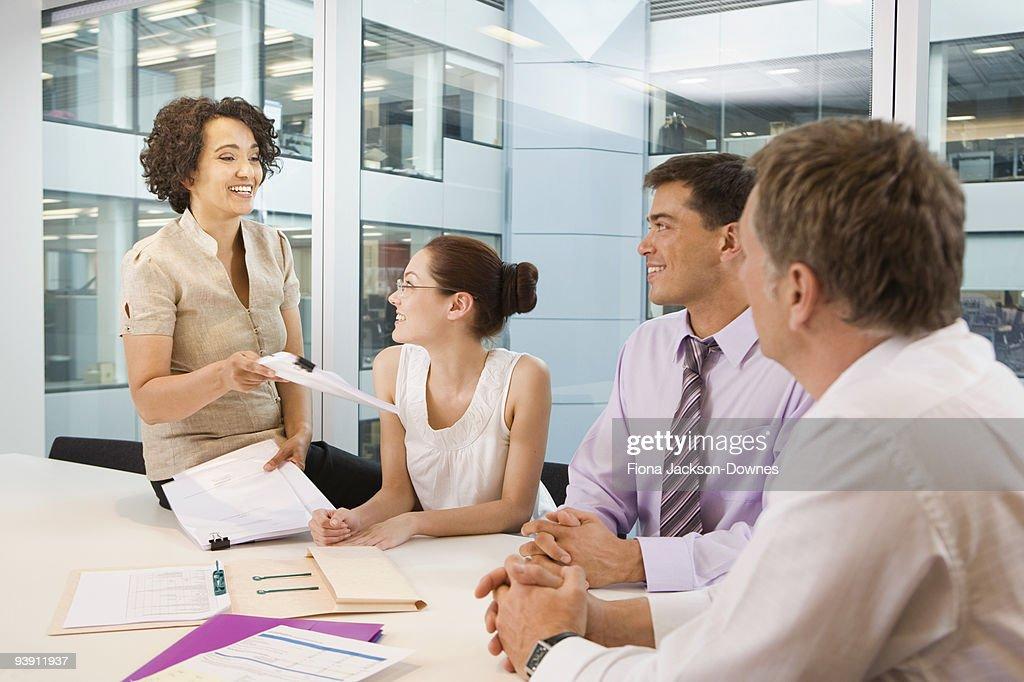 A senior female heads business meeting : Stock Photo