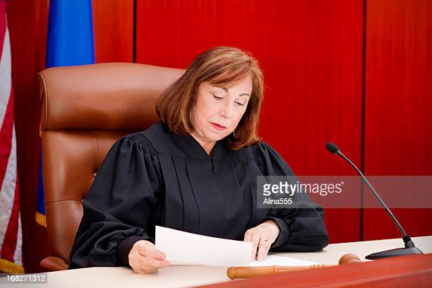 Senior female judge at the bench reading paper