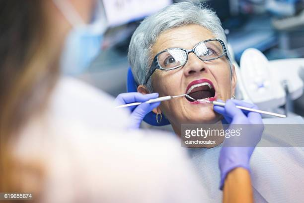 Senior female patient at dentist office