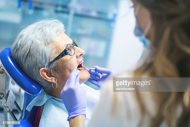 Senior female patient at dentist
