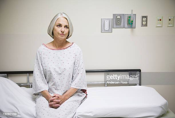 Senior female patient sitting on examination table, portrait