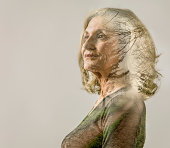 Senior female portrait with rural track overlay