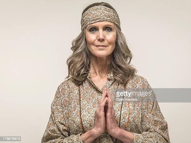 Senior female praying