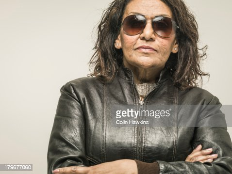 Senior female wearing sunglasses with attitude