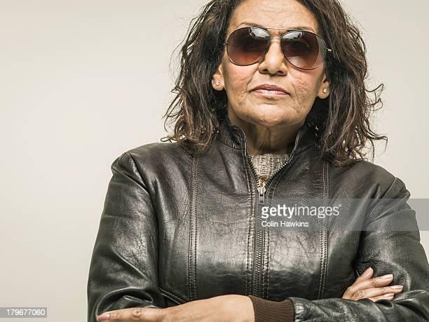 Senior female wearing sunglasses with attitude