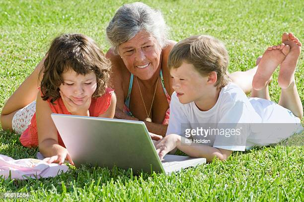 Senior female with children on laptop