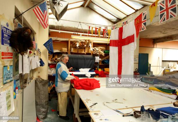 Senior Flagmaker Stuart Witham prepares a St George's flag at United Flags and Flagstaffs in Middleton Manchester before the ccelebrations on...