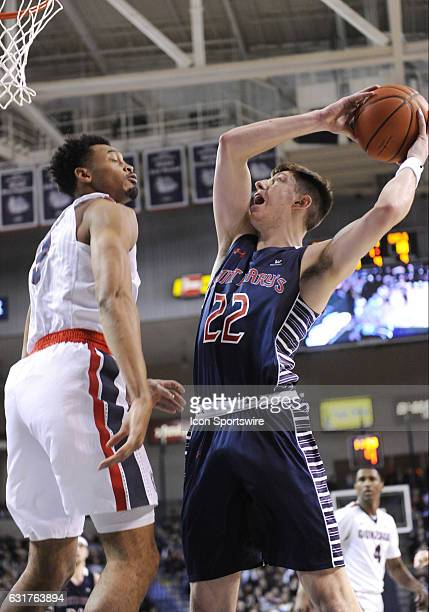 SMC senior forward Dane Pineau goes up to shoot over Gonzaga junior forward Johnathan Williams during the game between the Saint Mary's Gaels and the...