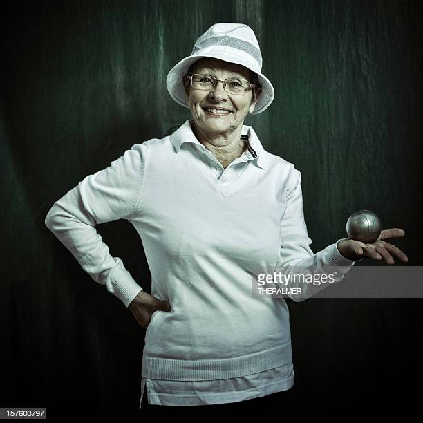 senior french petanque player woman
