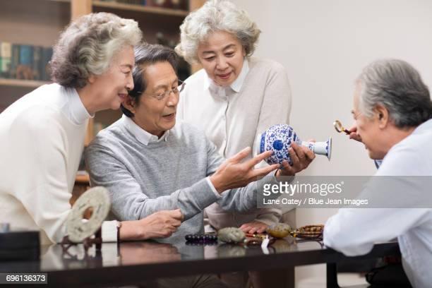 Senior friends admiring antiques