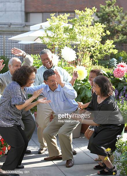 Senior friends dancing at outdoor party