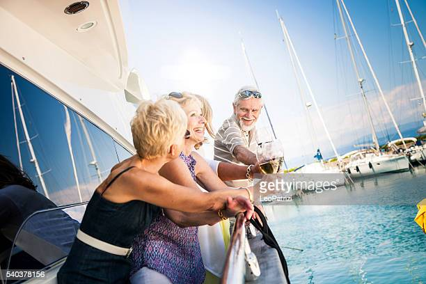 Senior friends having a weekend together on a yacht