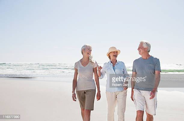 Senior friends walking on beach