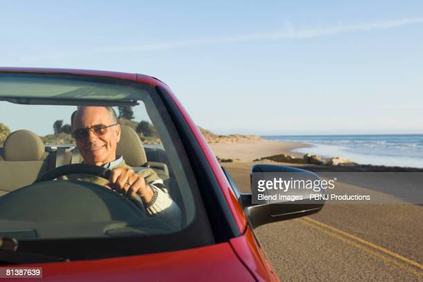 Senior German man driving convertible car