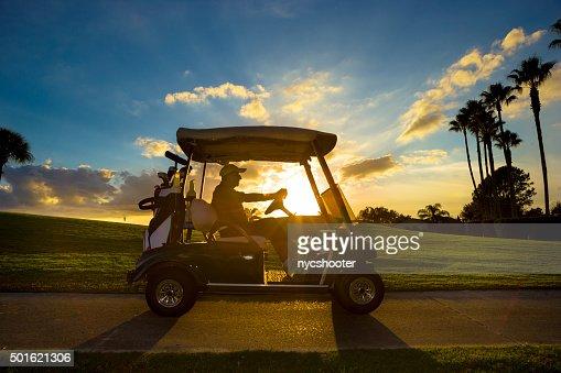 Senior golfer driving golf cart