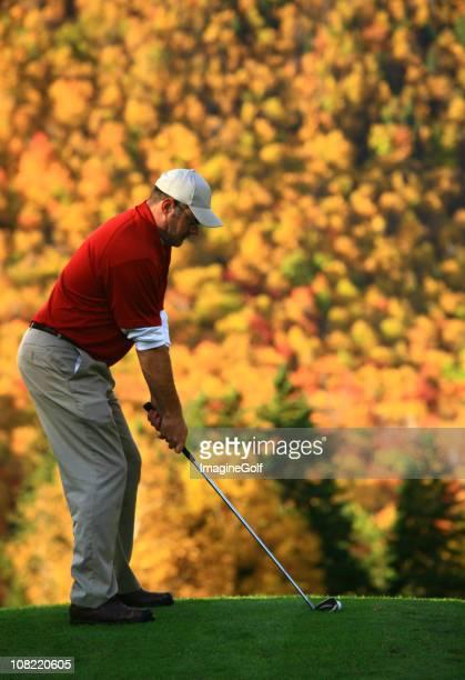 Senior Golfing During Autumn