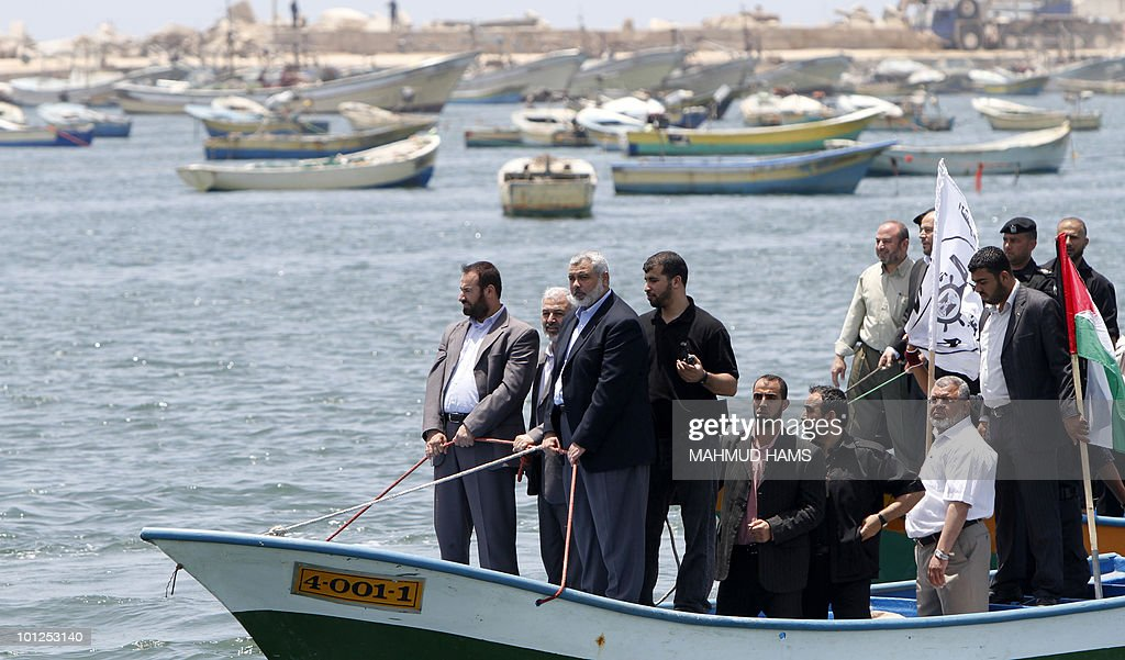 Senior Hamas leader Ismail Haniya (3rd-L) rides a boat off the coast of Gaza City on May 29, 2010 in preparation for the arrival of the 'Freedom Flotilla'. Organisers of the aid flotilla bound for the Gaza Strip in defiance of an Israeli embargo say it is determined to set sail from international waters off Cyprus, despite delays and threats to intercept the ships.