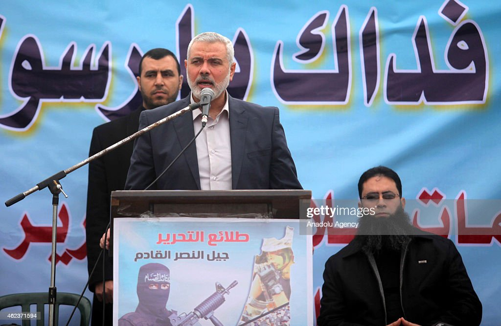 Senior Hamas leader Ismail Haniyeh (C) gives a speech during a military parade of Ezzedin al-Qassam Brigades, the armed wing of Hamas movement, in Gaza on January 27, 2015.