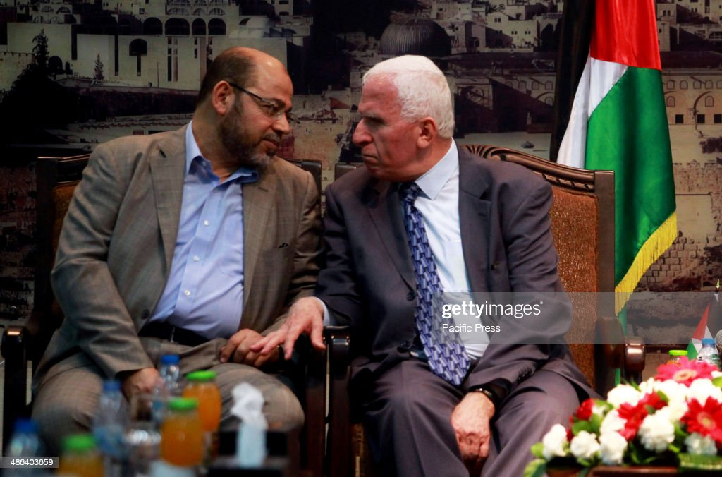 Senior Hamas leader Moussa Abu Marzouk and Azzam AlAhmed a senior Fatah official talk during their meeting in Gaza City on April 22 2014 The...