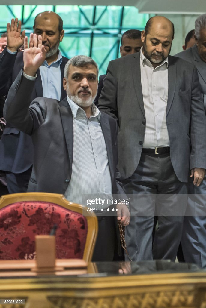 Senior Hamas Officials Izzat al-Rishq (L, bottom) and Mussa Abu Marzuq (R) are pictured after signing a reconciliation deal in Cairo on October 12, 2017, as the two rival Palestinian movements ended their decade-long split following negotiations overseen by Egypt. Under the agreement, the West Bank-based Palestinian Authority is to resume full control of the Hamas-controlled Gaza Strip by December 1, according to a statement from Egypt's government. /
