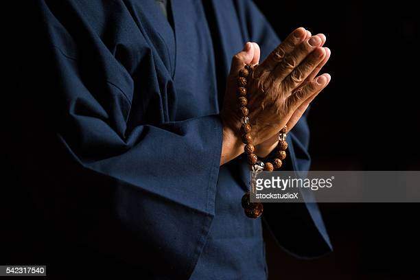 Senior hands with prayer beads