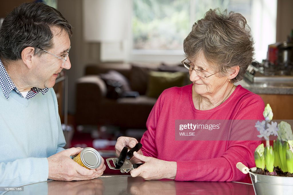 senior having occupational therapy home assessment holding can o