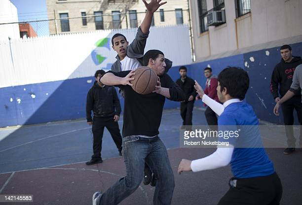 Senior high school boys at the Al Noor School play basketball March 8 2011 in the Brooklyn borough of New York The school does not offer an extensive...